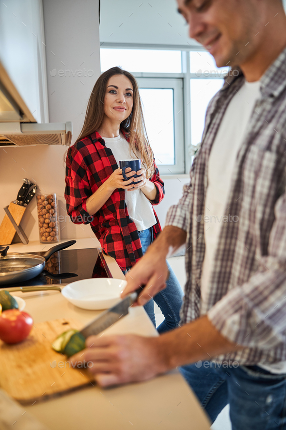 Wife admiring her spouse cooking for her - Stock Photo - Images