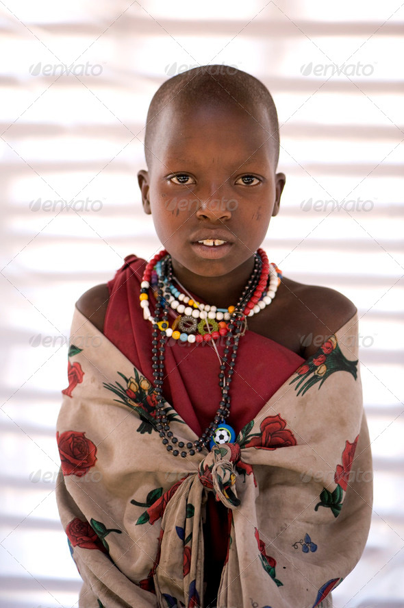 Portrait of a masai child looking at the camera - Stock Photo - Images