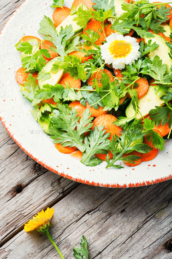 Diet salad with chrysanthemum leaves and avocado - Stock Photo - Images