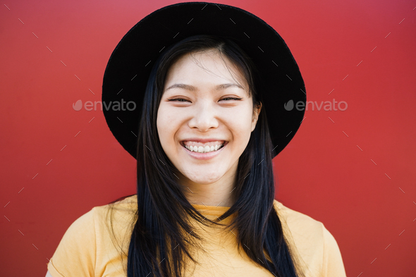 Happy asian hipster woman smiling on camera - Focus on face - Stock Photo - Images