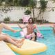 Happy people having fun inside swimming pool - Main focus on center man face - PhotoDune Item for Sale