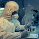 Contemporary scientist in coveralls studying one of medical samples - PhotoDune Item for Sale