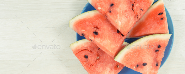 Slice of watermelon on blue plate, concept of healthy delicious dessert, copy space for text - Stock Photo - Images