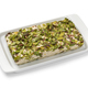 Traditional Turkish pistachio halva on a plate on white background - PhotoDune Item for Sale