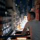 Man enjoying night city view from balcony - PhotoDune Item for Sale