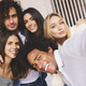 Multi-ethnic group of friends taking a selfie together while having fun outdoors - PhotoDune Item for Sale
