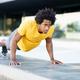 Black man doing triceps dip exercise on city street bench - PhotoDune Item for Sale