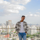 Portrait of African black man outdoors in city at rooftop during summer - PhotoDune Item for Sale