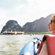 Young woman traveler with life jacket at sunset ride on kayak island hopping - PhotoDune Item for Sale