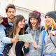 Group of young hipster tourists friends cheering with city map in the old town - PhotoDune Item for Sale