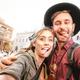 Happy boyfriend and girlfriend in love having genuine fun taking selfie at old town tour - PhotoDune Item for Sale