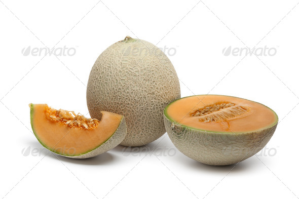 Whole and sliced Cantaloupe melon - Stock Photo - Images