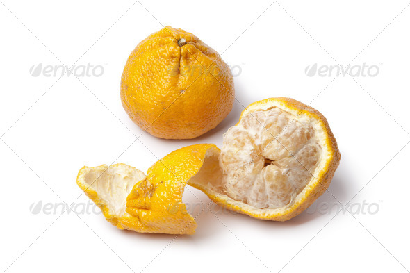 Whole and partial peeled ugli fruit - Stock Photo - Images