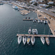 Mykonos island marina, aerial drone view. Sailboats and yachts anchored at port dock. - PhotoDune Item for Sale