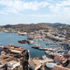 Syros island, Greece, aerial drone view. Saiboats moored at Ermoupolis port dock, yachts marina. - PhotoDune Item for Sale