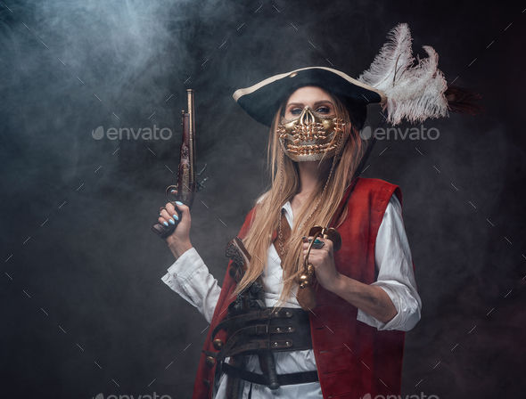 Dangerous woman corsair with mask and weapons - Stock Photo - Images
