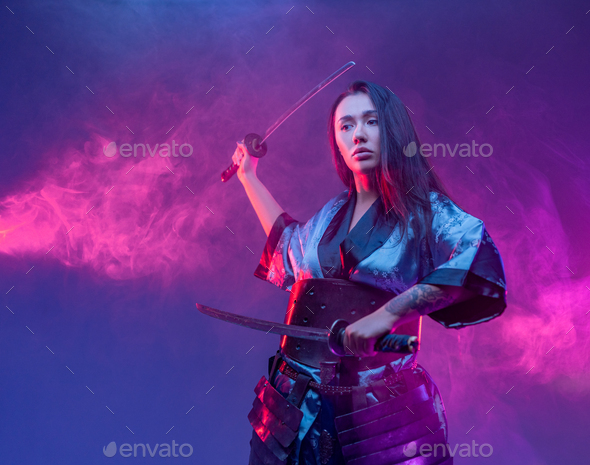 Cyberpunk style woman fighter with samurai swords - Stock Photo - Images
