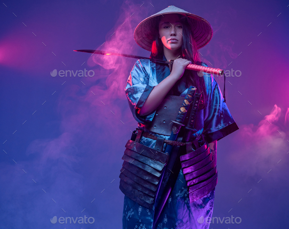 Woman samurai with bamboo hat and steel katana - Stock Photo - Images