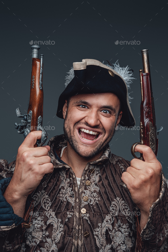 Portrait of crazy pirate with boarding pistols - Stock Photo - Images