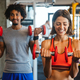 Beautiful fit people working out in gym together - PhotoDune Item for Sale