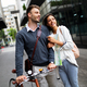 Holidays, dating and tourism concept. Smiling couple in love with map in the city - PhotoDune Item for Sale