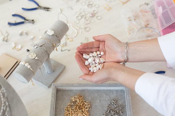 Professional jewelry designer making handmade jewelry in studio workshop. Fashion, creativity and - Stock Photo - Images