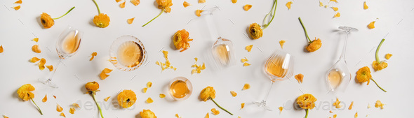 Trendy Orange or Amber wine and yellow flowers, wide composition - Stock Photo - Images