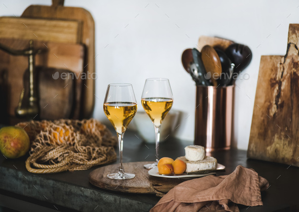 Two glasses of Trendy Orange or Amber wine and appetizers - Stock Photo - Images