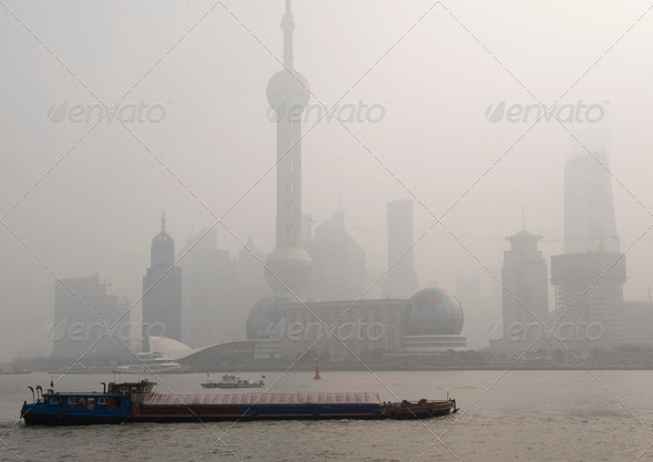 Air pollution over Shanghai, a barge is passing - Stock Photo - Images