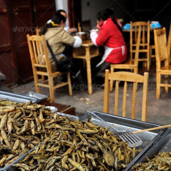 Fried fish on market - Stock Photo - Images