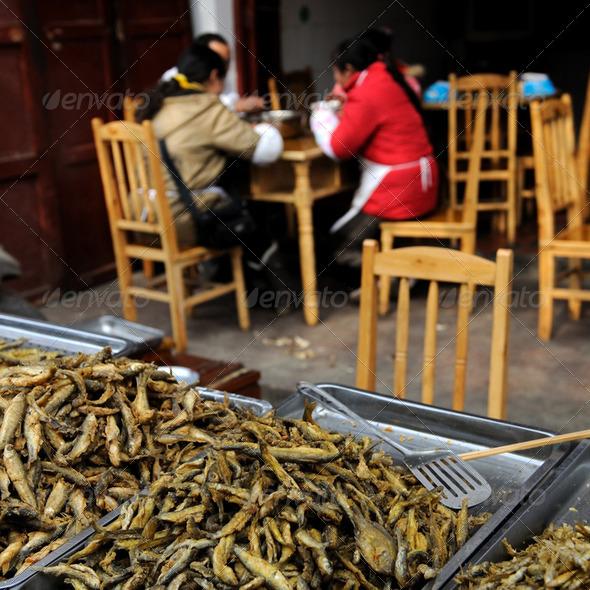 Fried fish on market - Stock Photo - Images