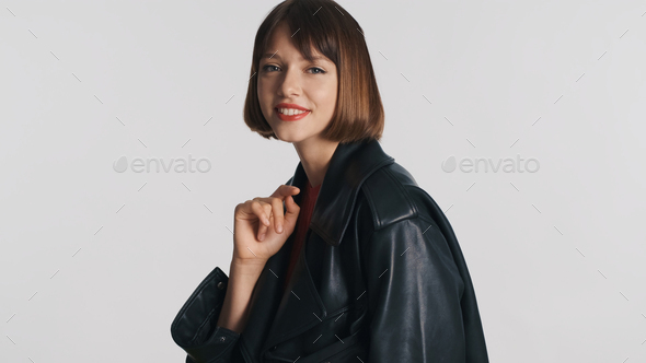 Attractive smiling girl with bob hair happily posing on camera isolated over white background - Stock Photo - Images