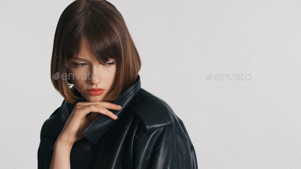 Upset pensive girl with bob hair looking frustrated isolated on white background. Sadness expression - Stock Photo - Images