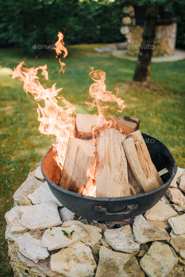 Fire pit in garden - Stock Photo - Images