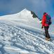 Mountaineer climbs a snowy peak in swiss Alps. Zermatt, Switzerland. - PhotoDune Item for Sale