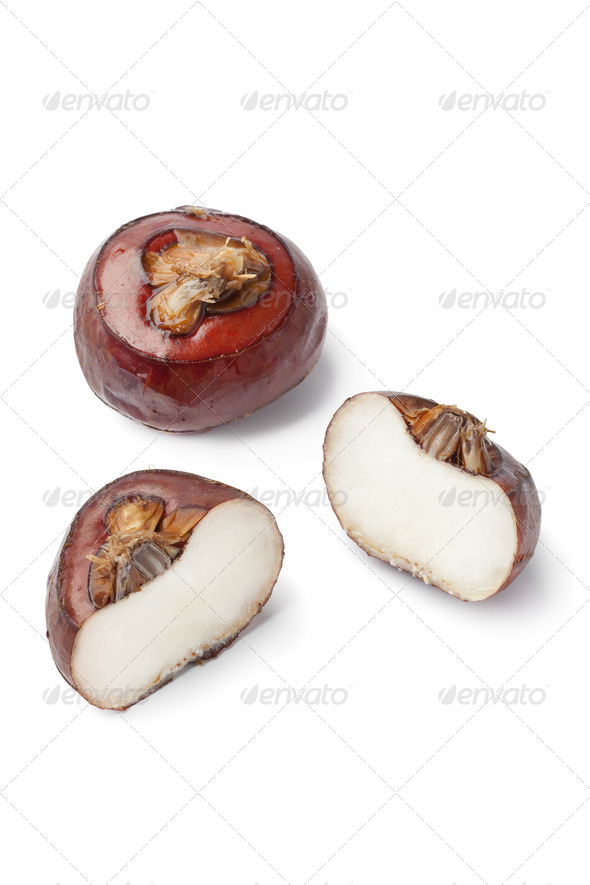 Whole and half water chestnuts - Stock Photo - Images