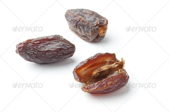 Whole and open dried dates - Stock Photo - Images