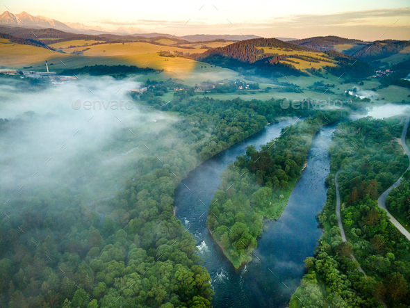 Fog and Mist at Sunrise Over Dunajec River in Pieniny, Poland. Aerial Drone View - Stock Photo - Images