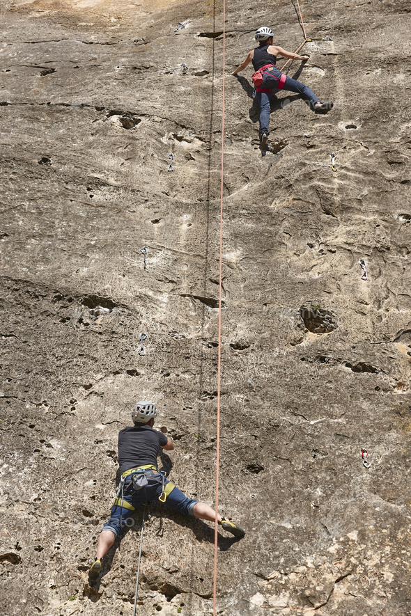 Climbers on a granite wall. Extreme sport. Outdoor mountain activity - Stock Photo - Images