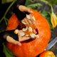 Girl, little child hands who pulls seeds and fibrous material from a pumpkin - PhotoDune Item for Sale