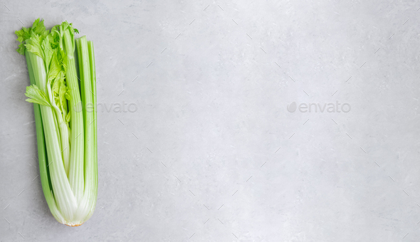 Celery. Fresh green organic celery on gray stone background, top view - Stock Photo - Images