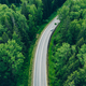 Aerial view of curved country road with cars and green summer woods. - PhotoDune Item for Sale