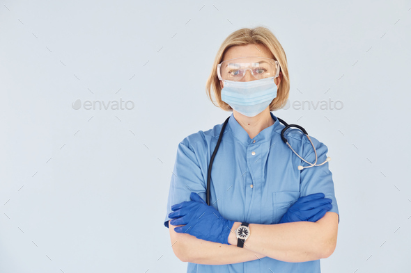 Middle-aged professional female doctor in uniform and with stethoscope - Stock Photo - Images