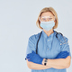 Middle-aged professional female doctor in uniform and with stethoscope - PhotoDune Item for Sale