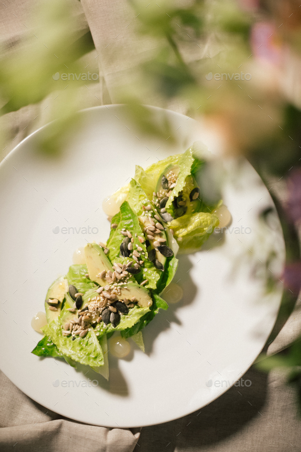 Keto diet food is wrapped instead of cakes in cabbage leaf with avocado. - Stock Photo - Images