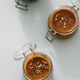 Salted caramel in glass jars, top view. Vertical - PhotoDune Item for Sale