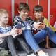 School children sitting and using smartphone at school - PhotoDune Item for Sale