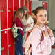 Portrait of girl with a backpack standing in school corridor - PhotoDune Item for Sale