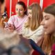 Group of schoolgirls using smartphone at school - PhotoDune Item for Sale