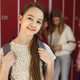 Portrait of smiling girl standing at school - PhotoDune Item for Sale